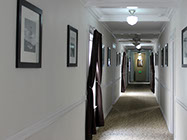 The Edgewater's long hallway leads either down to the beach or to our back patio deck.